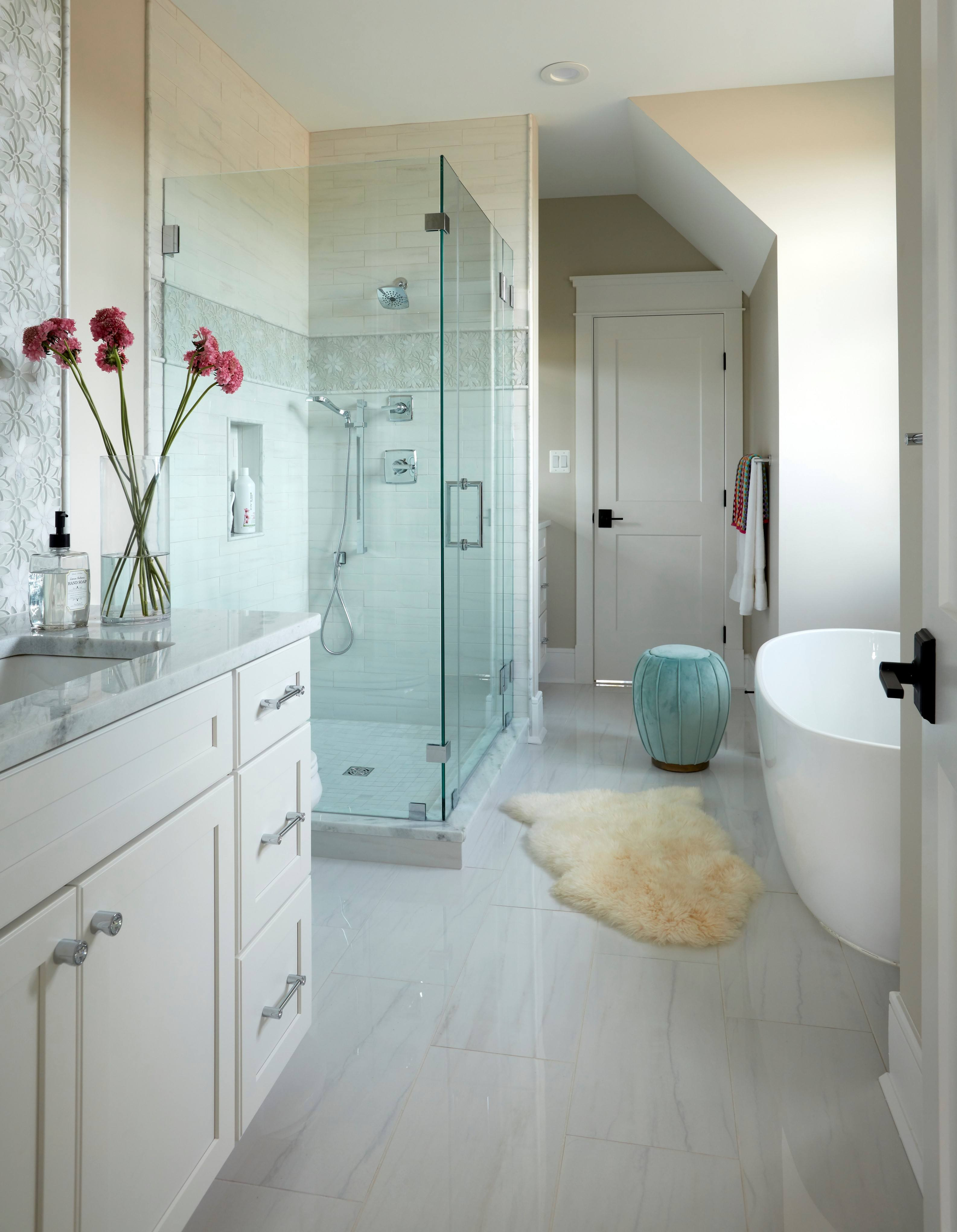 Dual vanities bathroom with shower and soaking tub