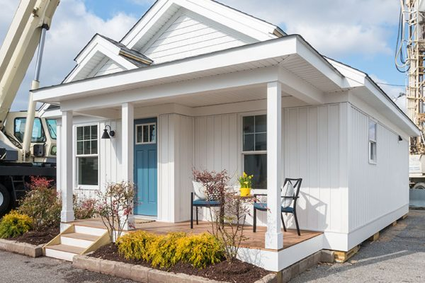 Senior Tiny Cottage with blue front door